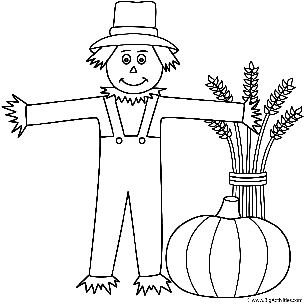 Scarecrow with wheat sheaf and